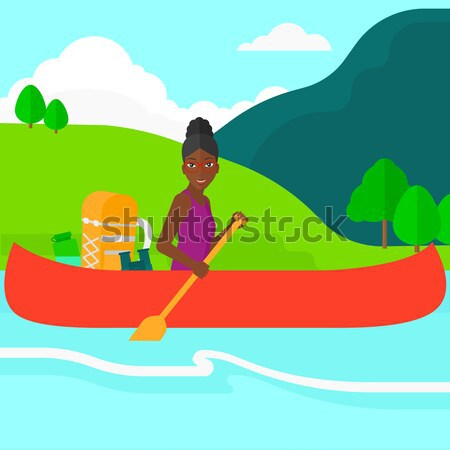 Woman canoeing on the river. Stock photo © RAStudio