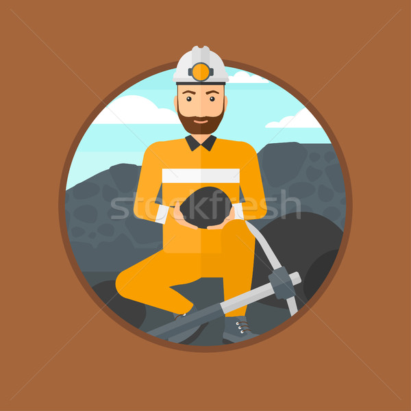 Miner holding coal in hands. Stock photo © RAStudio