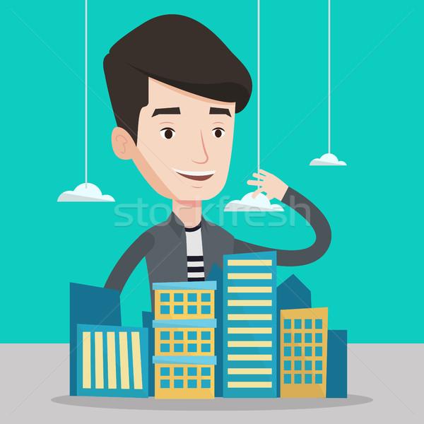 Real estate agent presenting city model. Stock photo © RAStudio