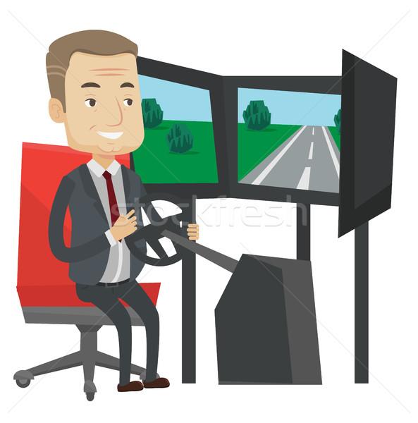 Férfi játszik videojáték számítógépes játékok kerék izgatott Stock fotó © RAStudio