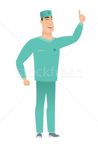 Kafkas doktor işaret işaret parmağı heyecanlı üniforma Stok fotoğraf © RAStudio