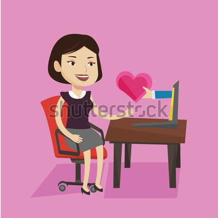 Young woman dating online using laptop. Stock photo © RAStudio