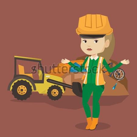 Worker and bulldozer at rubbish dump. Stock photo © RAStudio