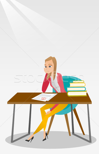 Sad student looking at test paper with bad mark. Stock photo © RAStudio