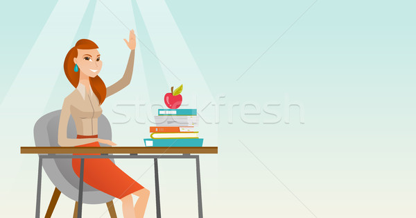 Student raising hand in class for an answer. Stock photo © RAStudio