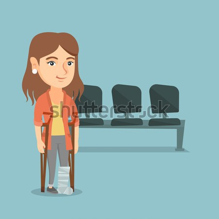Woman with broken leg and crutches. Stock photo © RAStudio