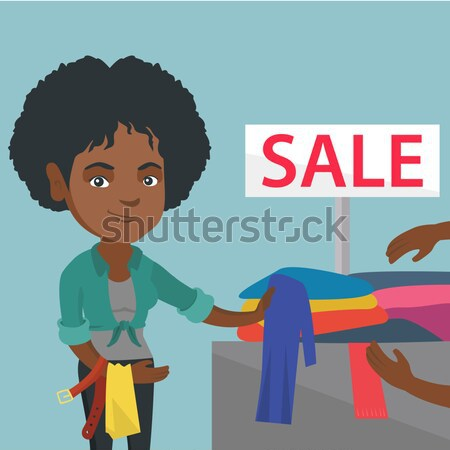 Young woman choosing clothes in shop on sale. Stock photo © RAStudio