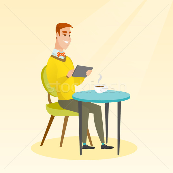 Man surfing in the social network in the cafe. Stock photo © RAStudio