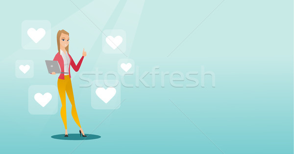 Woman with laptop and heart icons. Stock photo © RAStudio