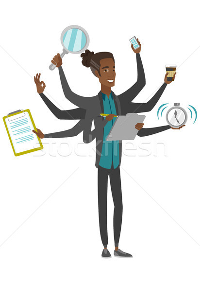 African businessman coping with multitasking. Stock photo © RAStudio