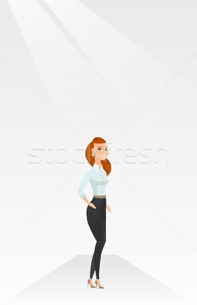 Woman posing on catwalk during fashion show. Stock photo © RAStudio