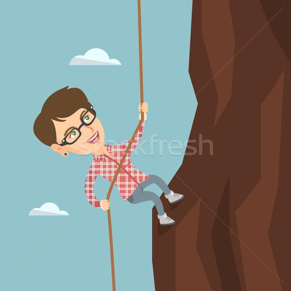 Caucasian business woman climbing the mountain. Stock photo © RAStudio