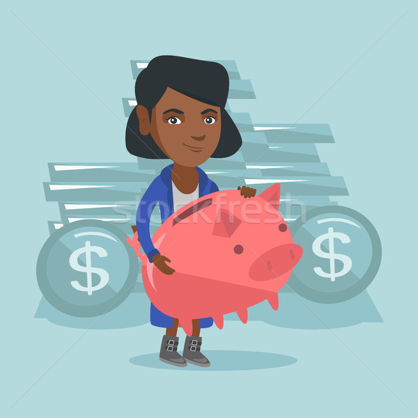 African-american business woman holding piggy bank Stock photo © RAStudio