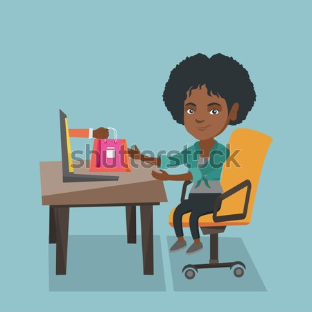African woman searching information on a laptop. Stock photo © RAStudio