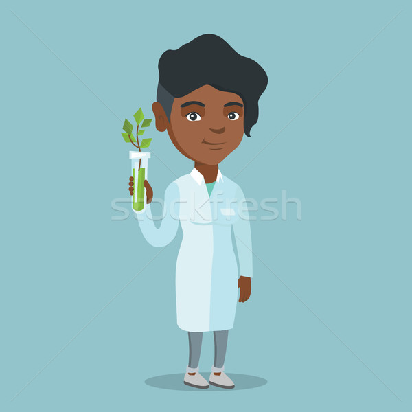 Scientist holding test tube with young sprout. Stock photo © RAStudio