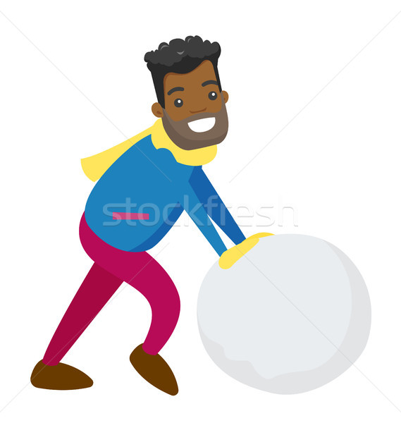 African-american man making snowball for snowman. Stock photo © RAStudio