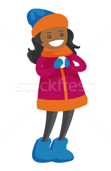 African-american girl holding a little snowball. Stock photo © RAStudio