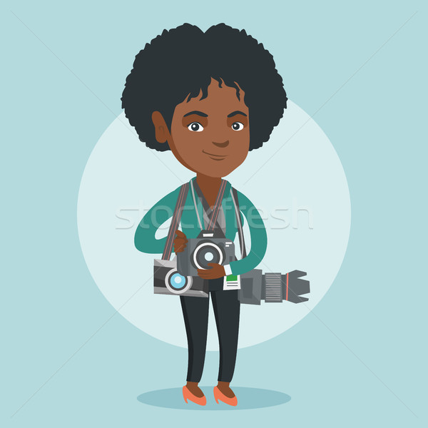 Young african photographer with photo cameras. Stock photo © RAStudio
