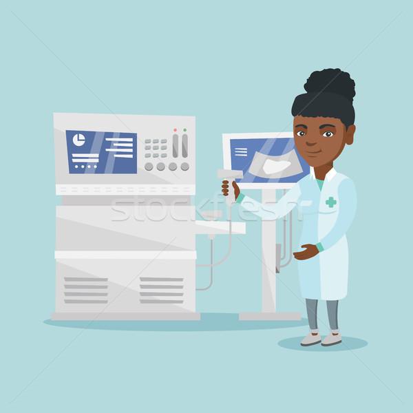 Young ultrasound doctor with ultrasound equipment. Stock photo © RAStudio