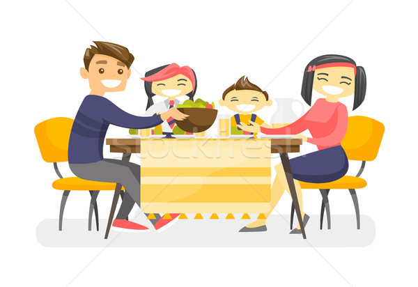 Happy multiethnic family dining at the table. Stock photo © RAStudio