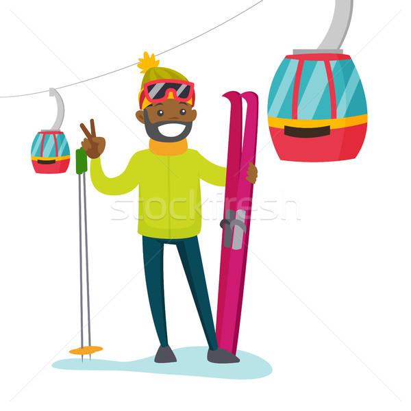 Skier on the background of cableway at ski resort. Stock photo © RAStudio