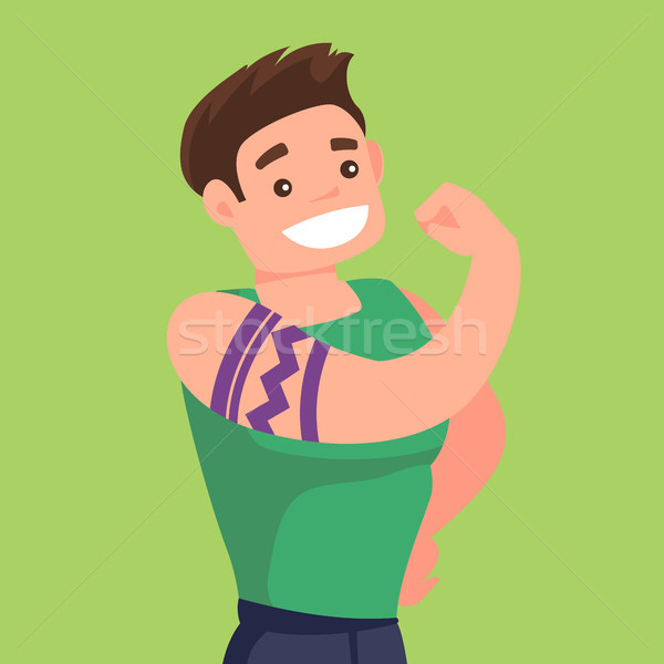 Caucasian white man with a tattoo showing biceps. Stock photo © RAStudio