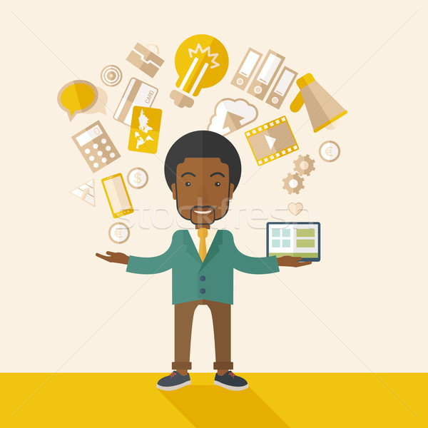 Happy Black man enjoying doing multitasking. Stock photo © RAStudio
