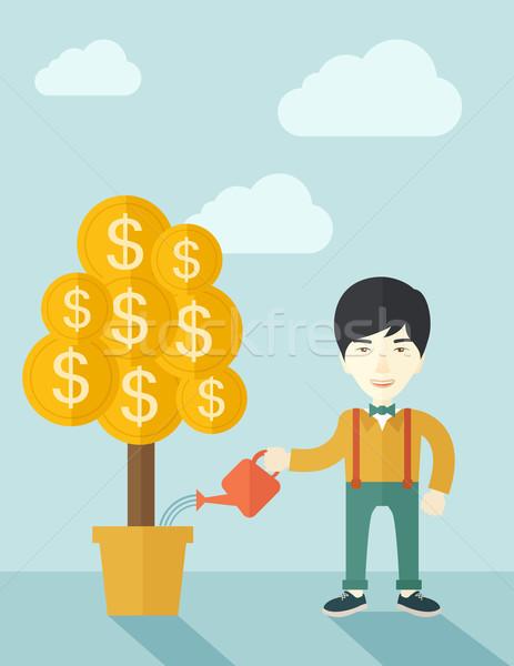 Asian businessman happily watering the money tree. Stock photo © RAStudio
