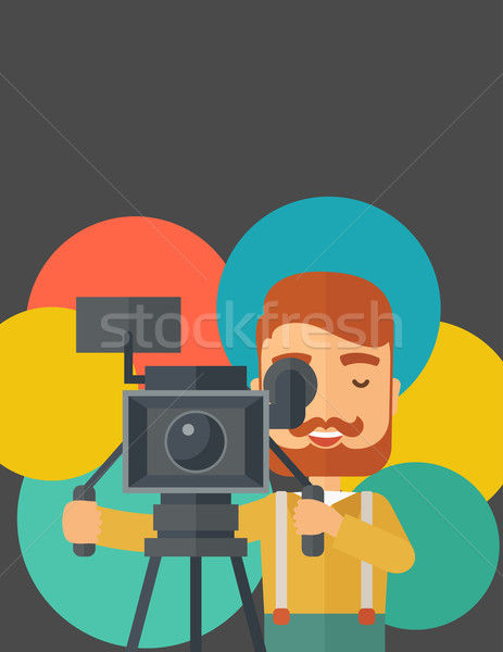 Videographer and his video cam with stand. Stock photo © RAStudio