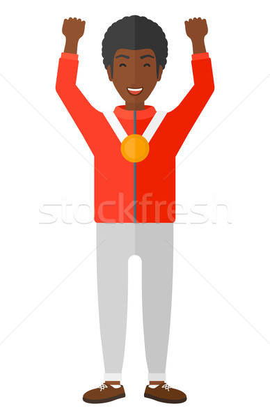 Athlete with medal and hands raised. Stock photo © RAStudio