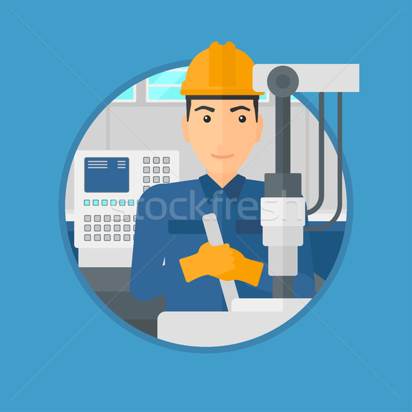 Man working on industrial drilling machine. Stock photo © RAStudio