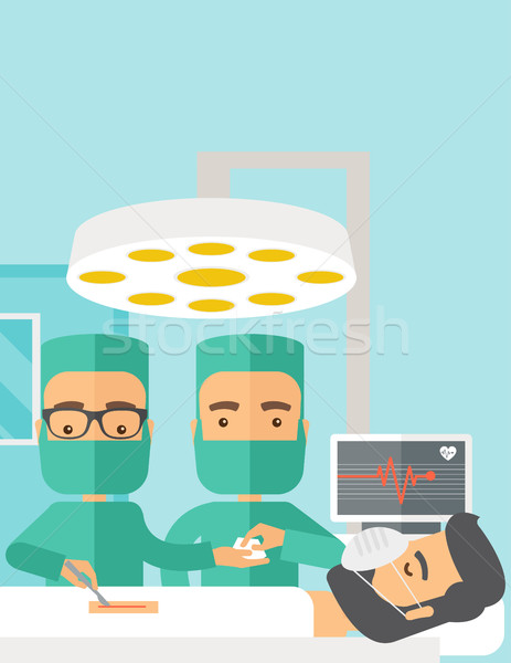 Two surgeons looking over a patient in an operating room Stock photo © RAStudio
