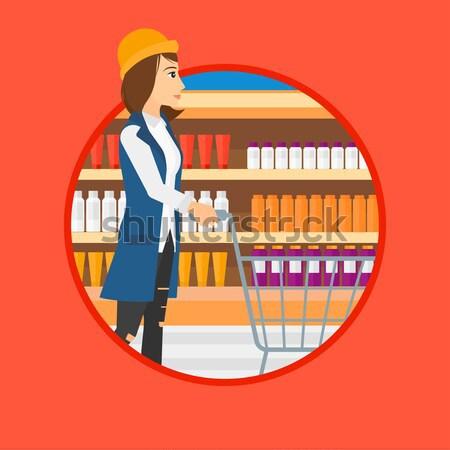 Customer with shopping trolley at supermarket. Stock photo © RAStudio