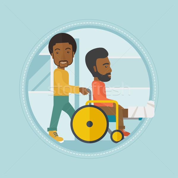 Man pushing wheelchair with patient. Stock photo © RAStudio