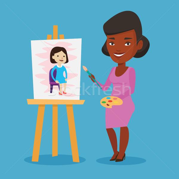 Creative female artist painting portrait. Stock photo © RAStudio