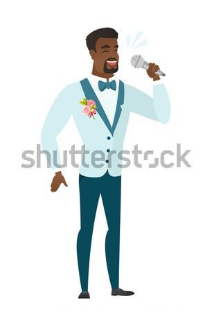 African-american groom holding a mobile phone. Stock photo © RAStudio