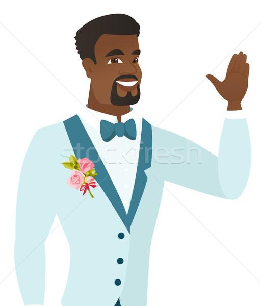 Fiatal vőlegény integet kéz esküvő öltöny Stock fotó © RAStudio