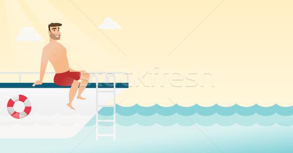 Young caucasian man tanning on the yacht. Stock photo © RAStudio