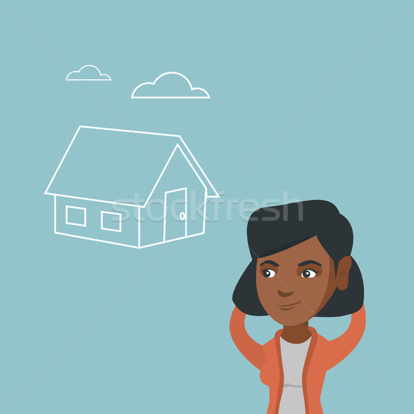 African woman dreaming about buying a new house. Stock photo © RAStudio