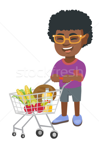 Little african boy with his shopping trolley. Stock photo © RAStudio