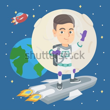 Caucasian kid spaceman with flag on a new planet. Stock photo © RAStudio