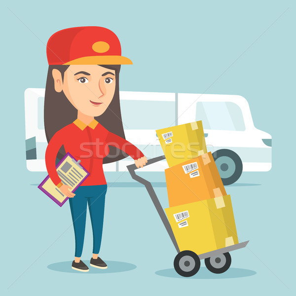 Delivery courier with cardboard boxes on troley. Stock photo © RAStudio