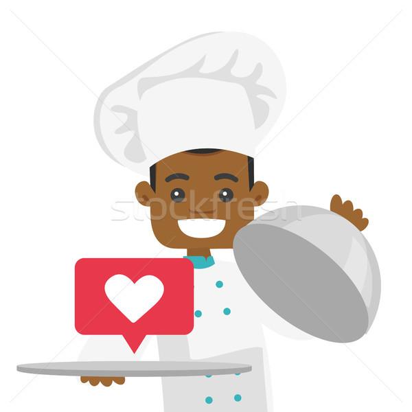 African waiter holding tray with heart like icon. Stock photo © RAStudio
