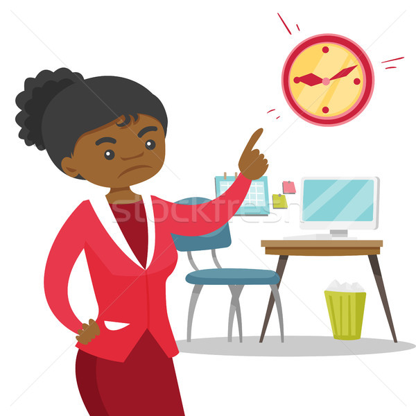 Angry african employer pointing to time on clock Stock photo © RAStudio