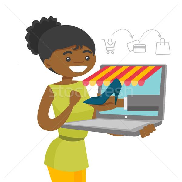 молодые женщину торговых онлайн счастливым Сток-фото © RAStudio