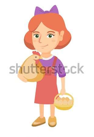 Caucasian girl holding a chicken and hen eggs. Stock photo © RAStudio