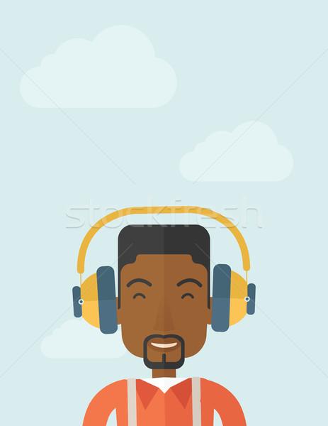 Fekete fiatal fickó fejhallgató boldog zenét hallgat Stock fotó © RAStudio