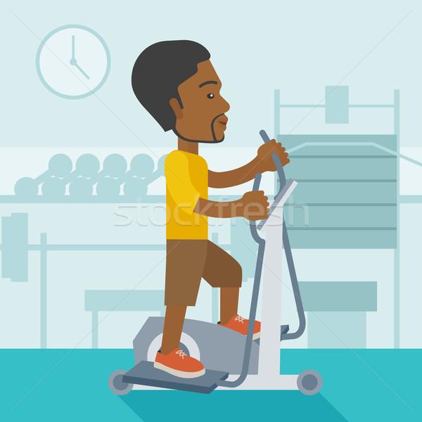 Adam egzersiz makine spor salonu vektör Stok fotoğraf © RAStudio