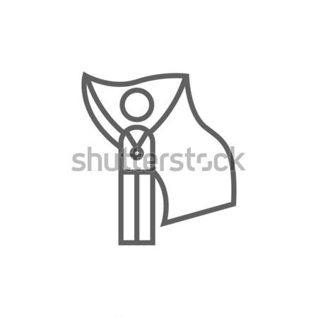 Medalist standing with flag line icon. Stock photo © RAStudio