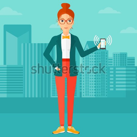 Woman holding ringing telephone. Stock photo © RAStudio